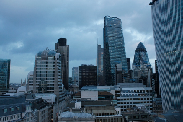 Londoners are quite creative when it comes to naming their architecture: The Cheese Grater, the Gerkin, and half in the picture, the Walkie Talkie. On the other side of the river is the Glass Testicle.