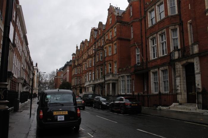 street scene with black cab