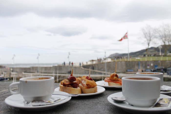 Pinxtos by the sea, with the Basque flag proudly flying in the background