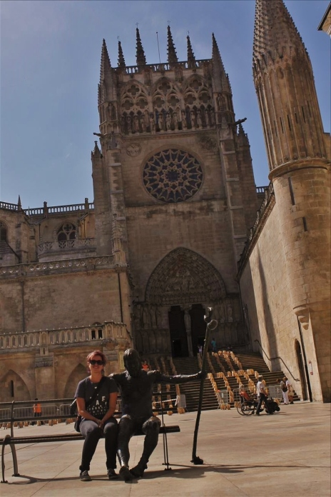 Me and a statue of a camino walker in Burgos, a city on the camino francés