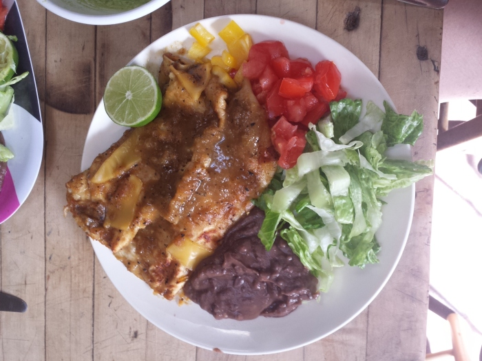 Delicious vegan enchiladas (complete with amazing non-dairy cheese), made entirely from the spoils of the Santa Fe hostel's kitchen.
